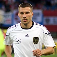 220px-lukas_podolski_germany_national_football_team_04